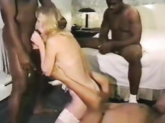 Slim blonde woman serves several black cocks simultaneously