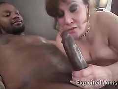 Amateur woman with big boobs tries to gag on black tool