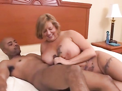 Interracial sex of black guys and busty woman ends with creampie